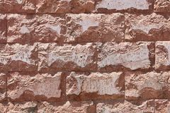 Pale Pink Wall Of Large Clay Bricks With Broken Edges.