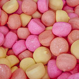 Pale pink and yellow candies Stock Photo