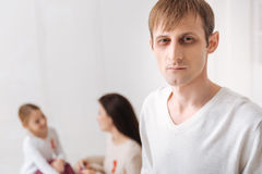 Pale serious man looking at you. Fight with AIDS. Pale serious young men standing and looking at you while fighting with AIDS Stock Photography