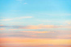 Pale sunset sky with pink, orange and red colors Royalty Free Stock Photo