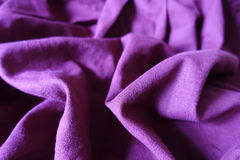 Violet linen fabric with folds and shadows. Pale violet linen fabric with folds and shadows Stock Photos