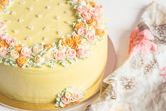 Pale yellow mousse cake with pastel cream flowers Stock Images