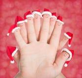 Palec twarze w Santa kapeluszach Szczęśliwy rodzinny odświętności pojęcie zdjęcie royalty free