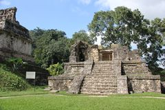 Palenque ancient Maya site, Mexico. Palenque, also anciently known as Lakamha, was a Maya city state in southern Mexico that flourished in the 7th century. The royalty free stock photo