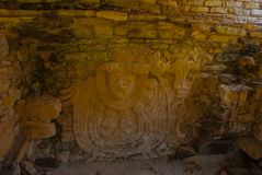 Palenque, Chiapas, Mexico. Ancient Mayan carved relief with in temple ruins. stock image