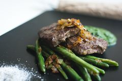 Paleo beef steak with green beans Stock Photos