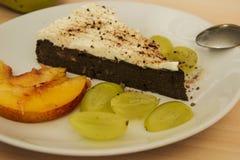 Paleo chocolate cake. Fresh paleo chocolate cake with wine on plate Stock Photo