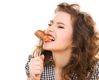 Paleo diet concept - woman eating meat. Paleo diet concept - young woman eating meat royalty free stock images