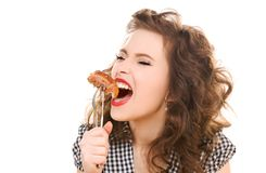 Paleo diet concept - woman eating meat. Paleo diet concept - young woman eating meat Royalty Free Stock Photos
