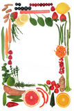 Paleo Diet Food Border. Paleo diet health food of fruit and vegetables forming an abstract border over white background. High in vitamins, antioxidants, minerals Stock Photography