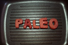 Paleo diet. Paleo letters cut from meat. Paleo diet Royalty Free Stock Image