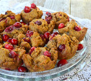 Paleo Pumpkin Cranberry Muffins. A glass platter of Paleo Pumpkin Cranberry Muffins made with coconut flour, maple syrup, pumpkin, cranberry, coconut oil stock photo