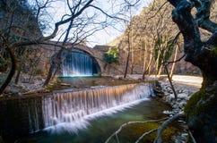 Paleokarya Old Stone Arched Bridge Between Two Waterfalls. Trikala Prefecture, Greece Stock Photos