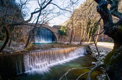 Paleokarya old stone arched bridge between two waterfalls. Trikala prefecture, Greece Stock Photos