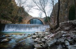 Paleokarya old stone arched bridge between two waterfalls. Trikala prefecture, Greece Royalty Free Stock Photography