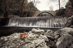 Paleokarya old stone arched bridge between two waterfalls. Trikala prefecture, Greece Royalty Free Stock Images