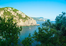 Paleokastritsa bay, Corfu Island, Greece. Summer view over the Ionian Sea, Paleokastritsa resort, Corfu Island, Greece, Europe Royalty Free Stock Image