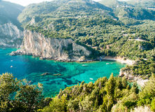Paleokastritsa bay, Corfu Island, Greece. Summer view over the Ionian Sea, Paleokastritsa resort, Corfu Island, Greece, Europe Stock Photography