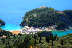 Paleokastritsa beach and bay view from above.Tilt-shit effect applied. Royalty Free Stock Photography