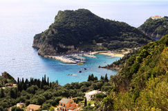 Paleokastritsa harbour. View from the mountain above of Paleokastritsa harbour, Corfu, with Paleokastritsa monastery top right. The sandy bays are among the stock photography