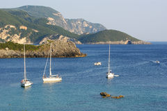 Paleokastritsa, island Corfu, Ionian sea, Greece. Kind on a bay Royalty Free Stock Photos