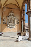 Palermo Cathedral Entrance Sicily Italy. Detail of the main entrance of Palermo Cathedral with a large stucco with religious motifs on a wall and an adorned arch Royalty Free Stock Images