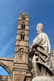 Palermo Cathedral Sicily Italy. A large tower and a white priest statue in the first plane at the Cathedral in downtown Palermo, Sicily, Italy Stock Photo