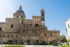 Palermo Cathedral in Palermo, Sicily, Italy. Facade of the cathedral of Palermo with people walking in the old town of Palermo in Sicily, Italy Royalty Free Stock Image