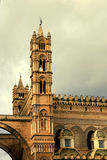 Palermo Cathedral tower on cloudy sky. Palermo Cathedral tower & small domes detail on cloudy sky, Norman Arabic architecture. Island of Sicily. Italy Royalty Free Stock Images