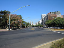 Palermo neighborhood in Buenos Aires. BUENOS AIRES - MARCH 30: Avenue of the Palermo neighborhood in a sunny day on March 30, 2013 in Buenos Aires Royalty Free Stock Image