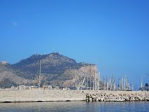 Palermo port with blue sky and water. Palermo port with blue sky and blue sea, boats moored beyond the wave breaker. Palermo, Sicily, Italy mediterranean summer royalty free stock image