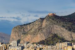 Palermo port with Mount Pellegrino and Utveggio Castle. Buildings near Palermo`s port with Mount Pellegrino and Utveggio Castle in the background, Palermo Stock Photos