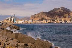 Palermo port with Mount Pellegrino and Utveggio Castle. PALERMO, ITALY - JNUARY 8, 2017: The port with Mount Pellegrino and Utveggio Castle in the background Royalty Free Stock Image