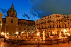Palermo, Sicily, Italy - night view of Fountain of shame on baroque Pretoria square at night. Blue hour Stock Photos