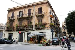 Palermo street corner with traditional style building. And market stock image