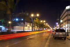Palestine street in Jeddah at night, with car lights motion Stock Image