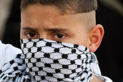 Palestinian Boy with Keffiyeh Mask Stock Image