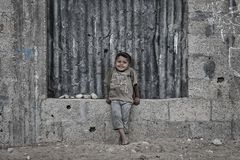A Palestinian child smiles from the dead neighborhoods of Gaza City. N royalty free stock images