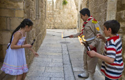 Palestinian children holds candeles Stock Photos