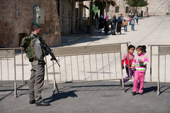 Palestinian children at Israeli military checkpoint Stock Photo