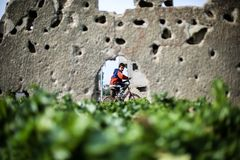 Palestinian child looking out the window of the shelling. Stock Photos