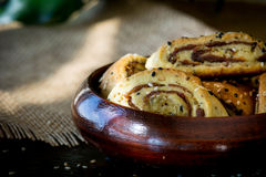 Palestinian cookie with dates called makrota ,مقروطة فلسطينية. Wood plate of date cookie called makrota Stock Image