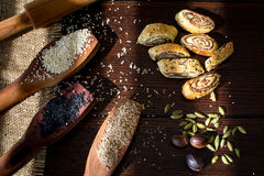 Palestinian cookie with dates called makrota. Date cookie called makrota on wood table with wooden spoons has fennel seeds black seeds and sesame Royalty Free Stock Photo