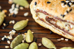 Palestinian cookie with dates called makrota. Zoom look on date cookie called makrota with cardamom on wood table Royalty Free Stock Photos