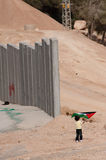 Palestinian Girl and Israeli Separation Barrier Stock Images