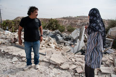 Palestinian house demolished by Israel. Salim and Arabiya Shawamreh stand among the ruins of their house, which was demolished for the sixth time by Israeli Royalty Free Stock Images