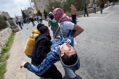 Palestinian injured in demonstration Stock Photo