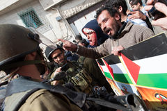Palestinian protest and Israeli soldiers Stock Photography
