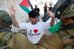 Palestinian protest and Israeli soldiers Royalty Free Stock Photo