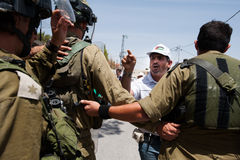 Palestinian protest and Israeli soldiers Royalty Free Stock Photography